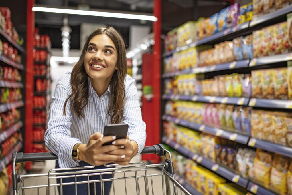 Smiling woman at supermarket.